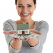 Young beautiful woman with money and house . — Stockfoto