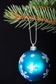 One christmas ball handing on a twig. — Foto de Stock