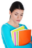 Portrait of young sad female student with workbook. — Stock Photo