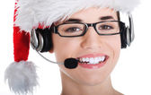 Portrait of woman in santa hat with microphone and headphone. — Stock Photo