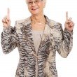 An old casual lady pointing up on copy space. — Stock Photo #36906391