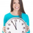 Young casual woman is holding a clock. — Stock Photo #36906761