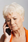 An old lady talking through phone. — Foto Stock