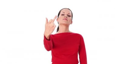 Young woman showing middle finger up. Over white background. — Stock Video