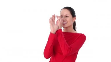 Female shows big fool nose gesture. Over white background. — Vídeo Stock