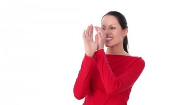 Female shows big fool nose gesture. Over white background. — Stock Video