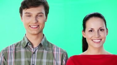 Man telling woman some secrets over green screen background — Stock Video
