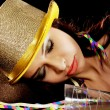 Young beautiful drunk woman sleeping on a table. — Stock Photo