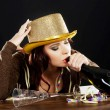 Stock Photo: Drunk young womcelebrating new years eve.