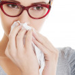 Young beautiful woman having runny nose, with tissue. — Stock Photo #37747551