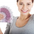 Beautiful young woman holding large sum of money. — Foto Stock
