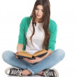 Young beautiful student sitting with book, reading, learning. — Stock Photo