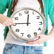 Stock Photo: Young casual woman holding clock.