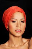 Attractive woman's face in turban. Closeup. — Stock Photo