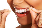 Attractive woman with dental floss. Closeup. — Stock Photo