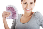 Beautiful young woman holding large sum of money. — Stock Photo