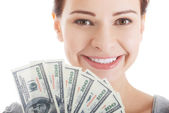 Young beautiful casual woman holding large sum of money. — Stock Photo