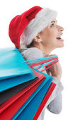 Beautiful woman in santa hat with shopping bags. — 图库照片