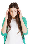 Young casual woman is having headache. — Stock Photo