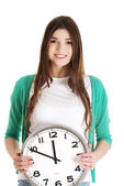 Young casual woman holding clock. — Stock Photo