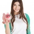 Stock Photo: Young casual woman holding piggy-bank.