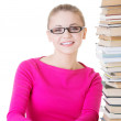 Young happy student with stack of books. — Stock Photo