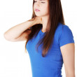 Young casual woman is touching her neck. — Stock Photo