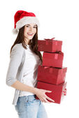 Beautiful woman in santa hat holding presents. — ストック写真