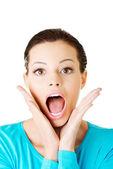 Beautiful casual woman expresses shock. — Stock Photo
