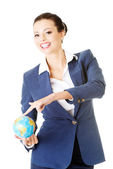 Young business woman holding small globe. — Stock Photo
