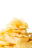Yellow, tasty but unhealthy potatoe chips. — Stock Photo