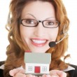 Call center assistant woman with house model — Stock Photo #38947371