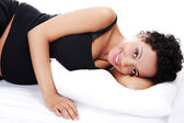 Pregnant woman sleeping on bed — Stockfoto