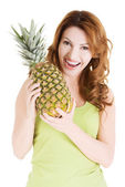 Happy woman with fresh pineapple fruit — Stock Photo
