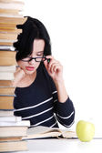 Young student woman studying at the desk — Foto de Stock