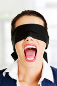 Beautiful frighten young blindfold woman — Stock Photo