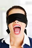 Beautiful frighten young blindfold woman — Stock Photo