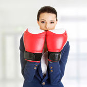 Young businesswoman with boxing gloves — Foto de Stock