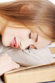 Beautiful woman is sleeping on a book. — Stock Photo