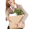 Beautiful business woman holding box with office items. — Stock Photo