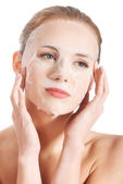 Beautiful young woman with collagen mask. — Stock Photo
