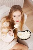 Beautiful caucasian sad woman eating ice creams. — Stock Photo