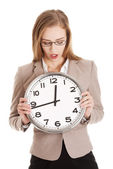 Young caucasian business woman holding clock. — Stock Photo