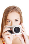 Beautiful caucasian summer woman taking photo. — Stock Photo