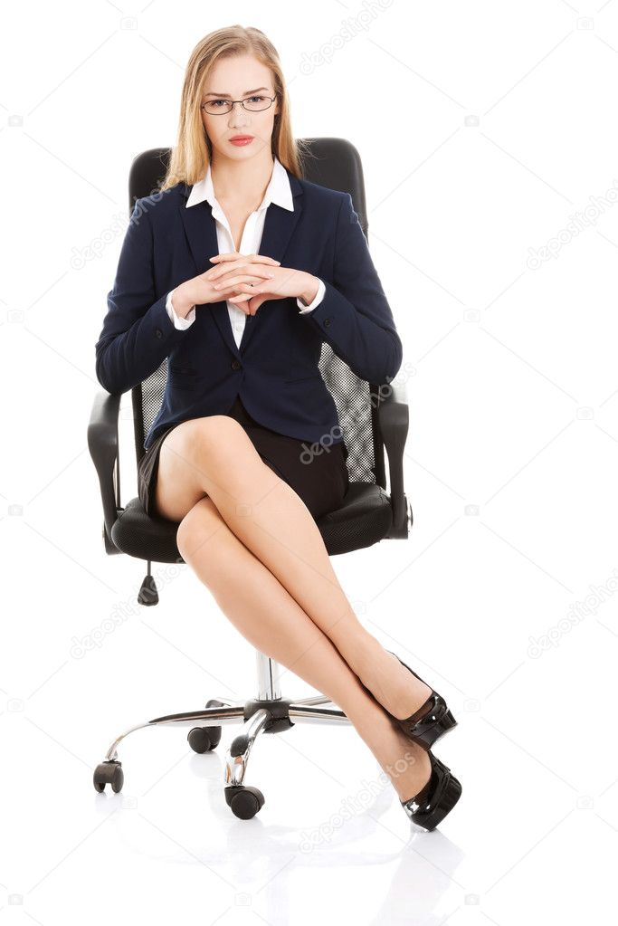 Beautiful Young Business Woman Sitting On A Chair Stock