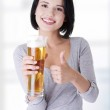 Beautiful and sexy young woman with beer — Stock Photo #39715567