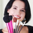 Young make-up artist woman holding brushes — Stock Photo