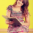 Stock Photo: Teen woman reading a book