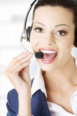 Beautiful young call-center assistant — Stock Photo