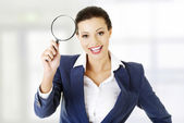 Business woman with magnifying glass — Stock Photo